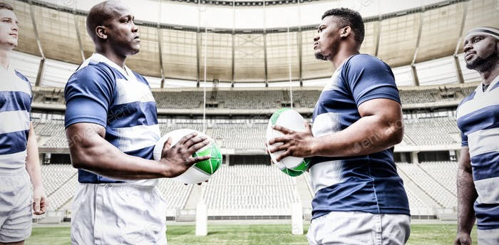 Digital composite image of team of rugby players facing each other while holding rugby ball in sport