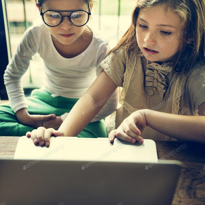 Little Girls Using Laptop Concept