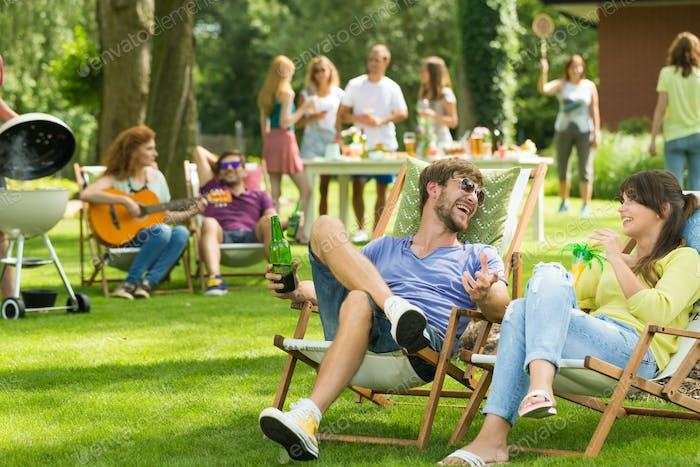Friends sit on sunbeds
