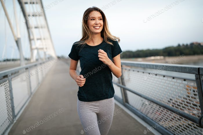 Sport, health, lifestyle and exercise concept. Sporty fit woman running