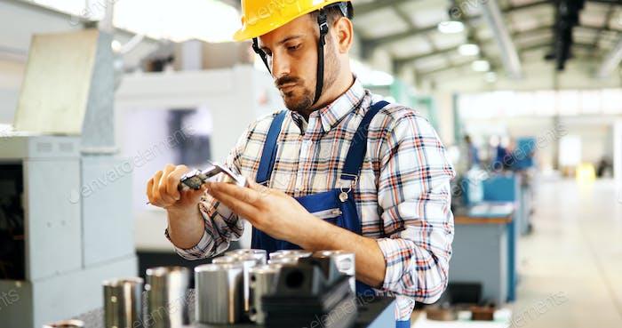 modern industrial machine operator working in factory