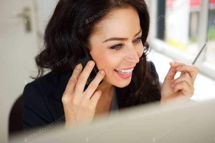 Cheerful business woman on cellphone