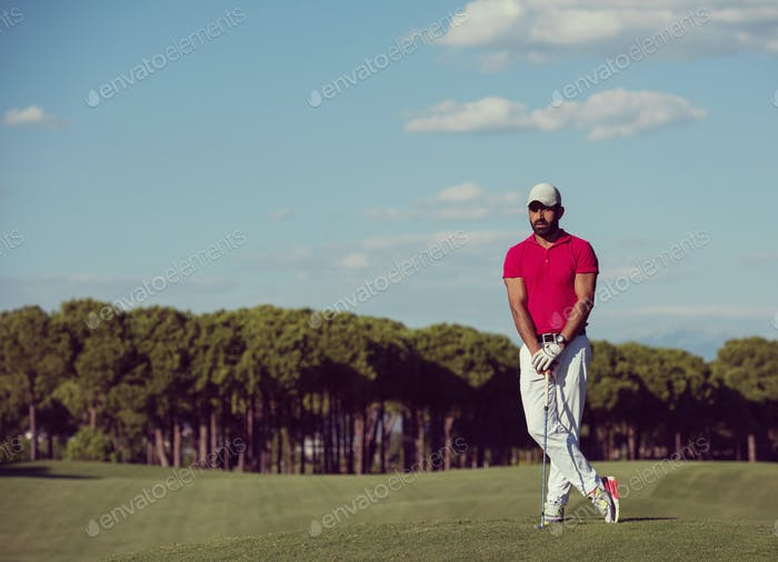 handsome middle eastern golf player portrait at course