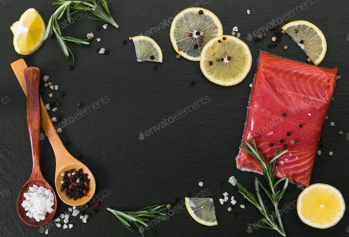 Fresh salmon fillet with spices and lemon.