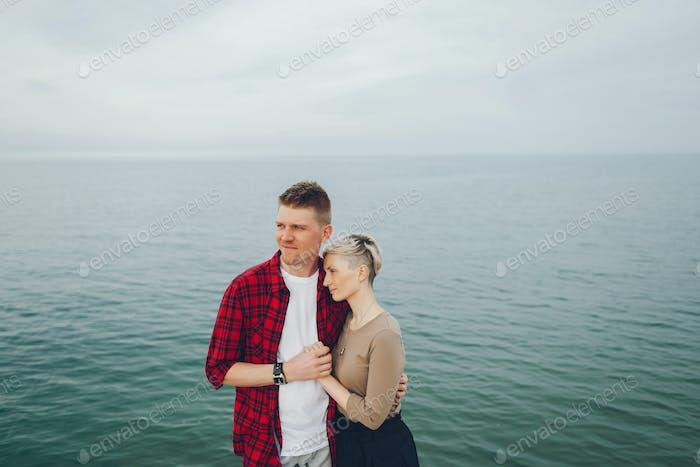 happy couple near ocean