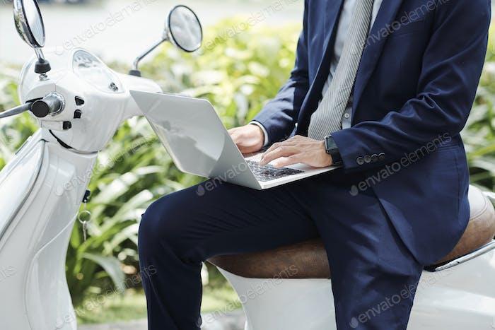Digital nomad working on laptop