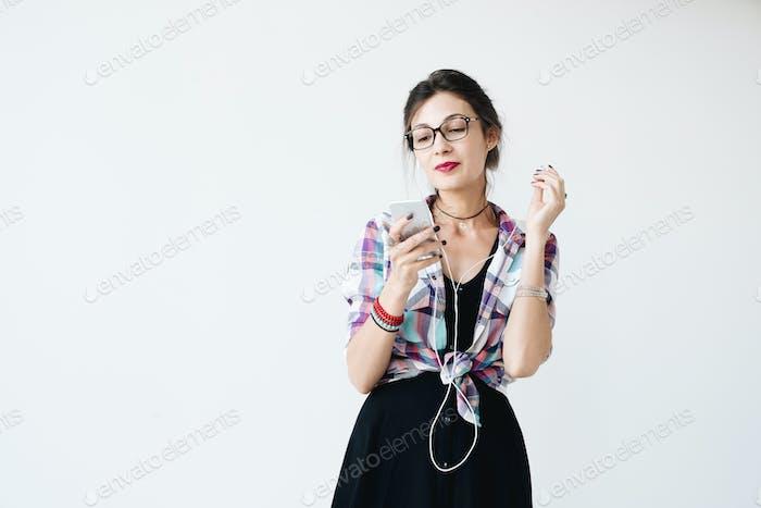 Girl putting on her earphones