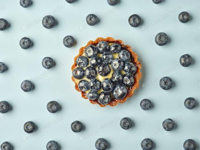 blueberry tart on light blue background