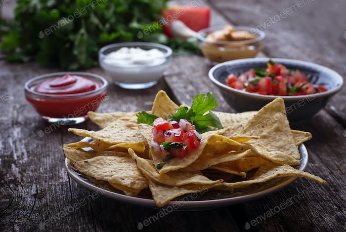 Mexican corn chips nachos with salsa dip