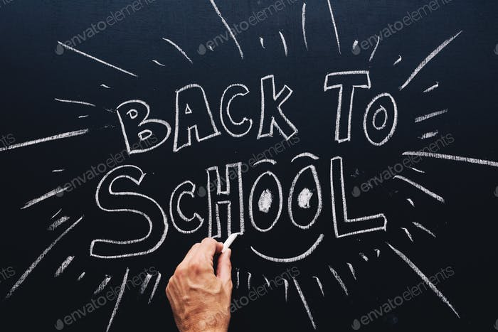 Back to School written on classroom chalkboard