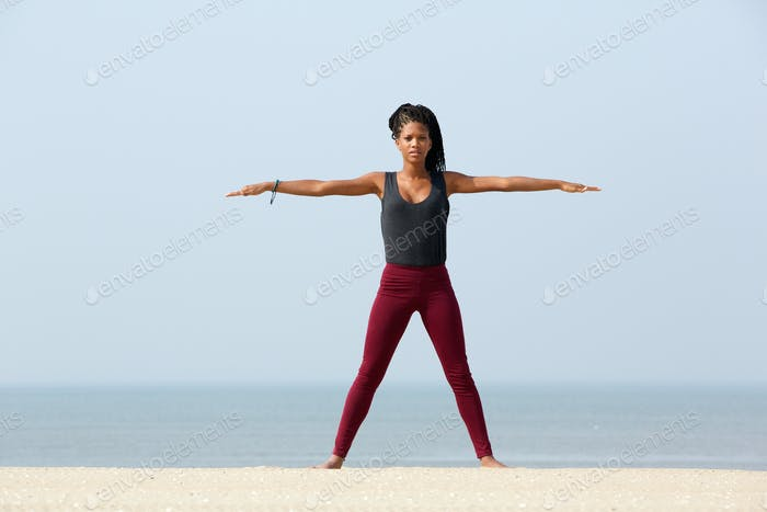 Yoga stretch at the beach