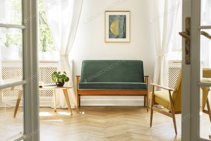 Living Room Interior With A Green Sofa