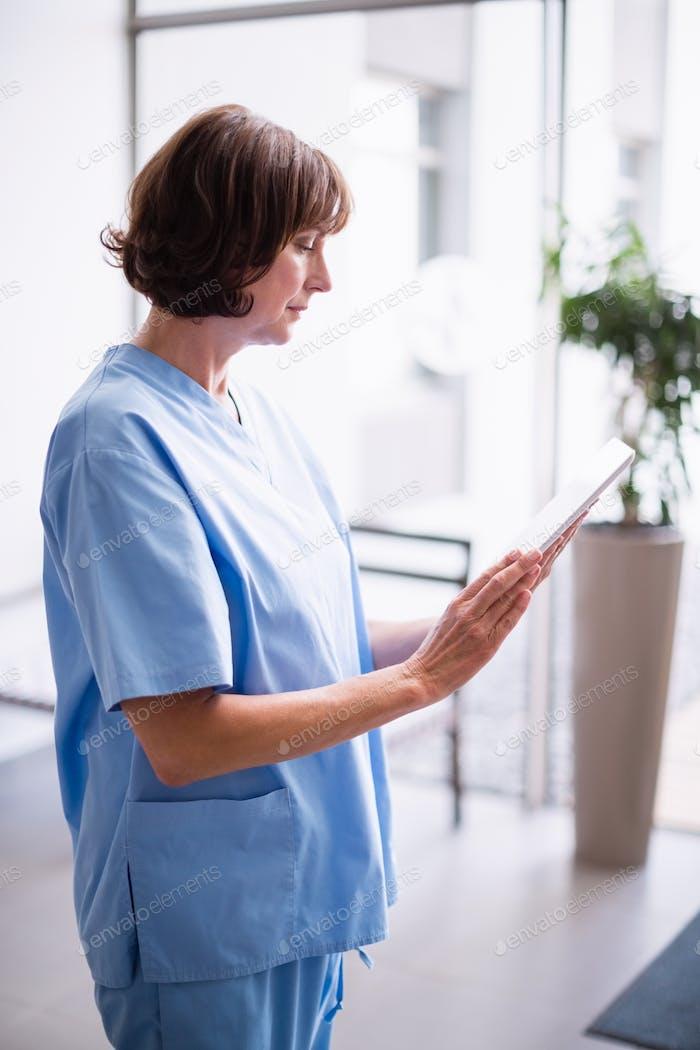 Nurse using digital tablet