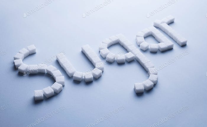 Sugar text made of white sugar cubes
