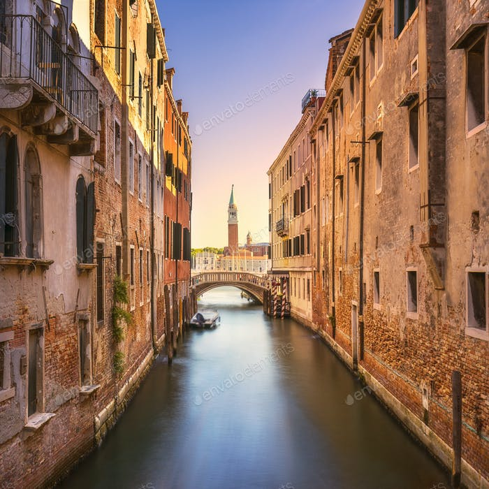Venice cityscape, water canal, campanile church and bridge. Ital