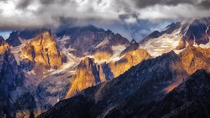 Detail of dramatic mountain range with colorful sunlight, Svaneti