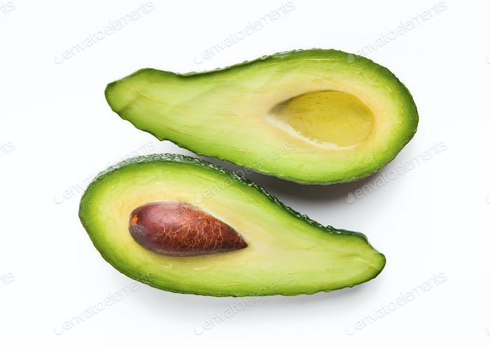 Two halves of ripe avocado