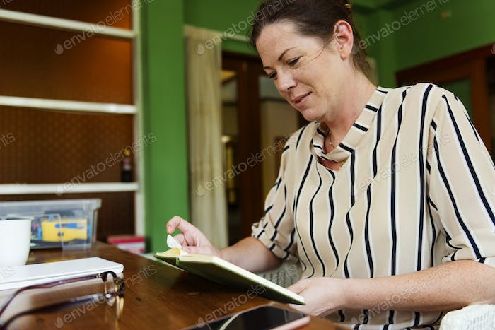 Caucasian woman reading a book