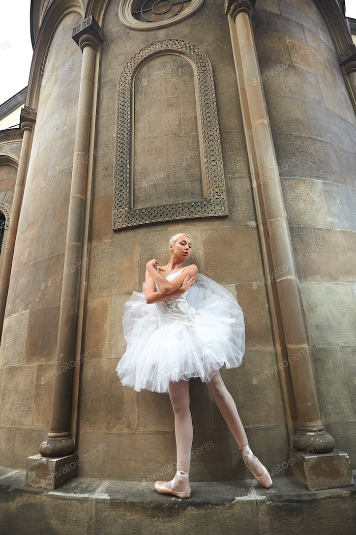 Ballerina performing near an old castle