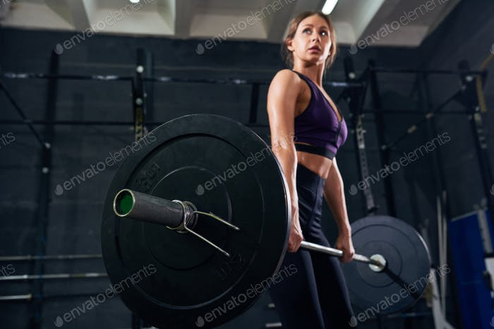 Beautiful Woman Holding Heavy Barbell