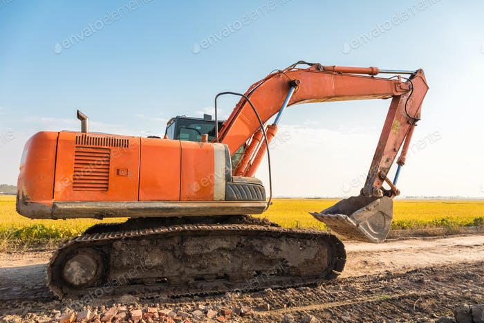 excavator on the country road