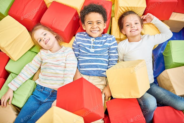 Three Kids Playing in Foam Pit
