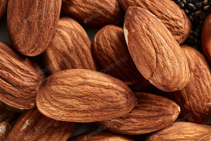 Nuts almond background, close-up view of nuts. Healthy vegan snack. Top view