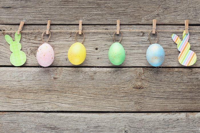 Colourful eggs and raper rabbits on rope