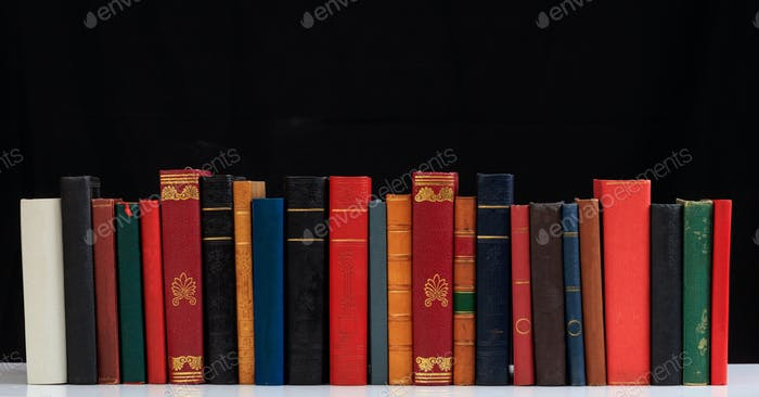 Vintage books on black background
