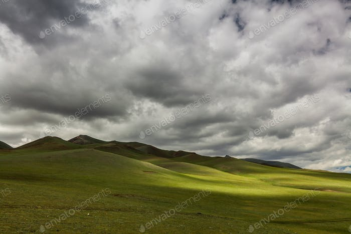 Green hills with clouds. Mongolian hills