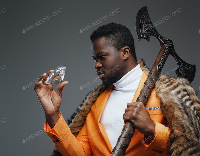 Wealthy black guy with fur holding diamond