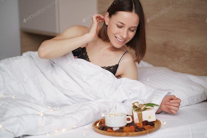 Presents, coffee and sweet awaking woman