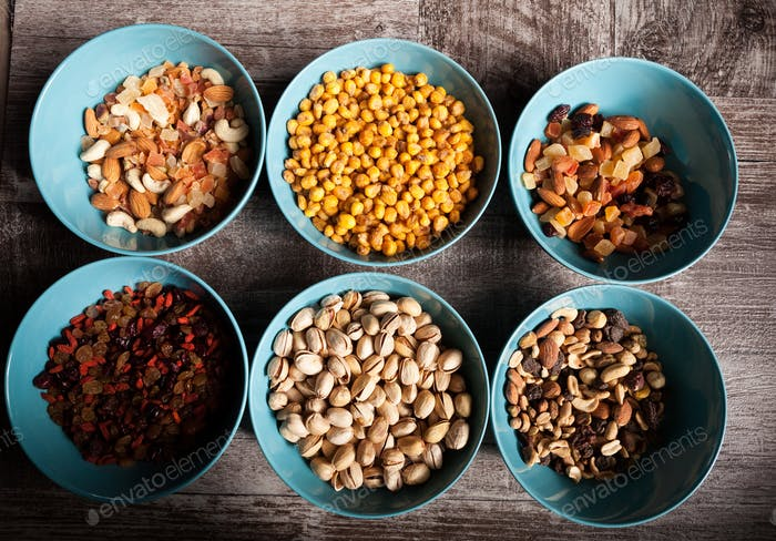 Mix of different type of nuts in bowls