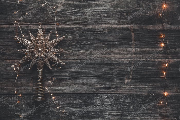 Christmas star on a gray background with garlands. New Year's scenery