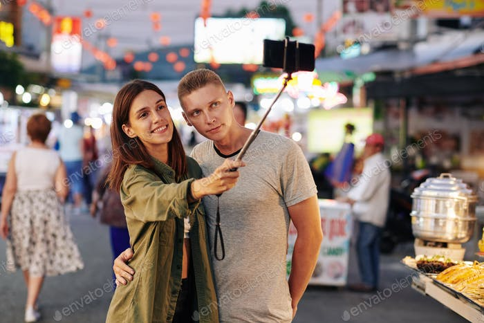 Couple photographing at market