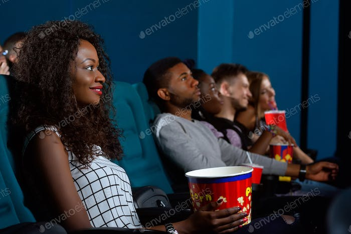 Young African woman watching a movie