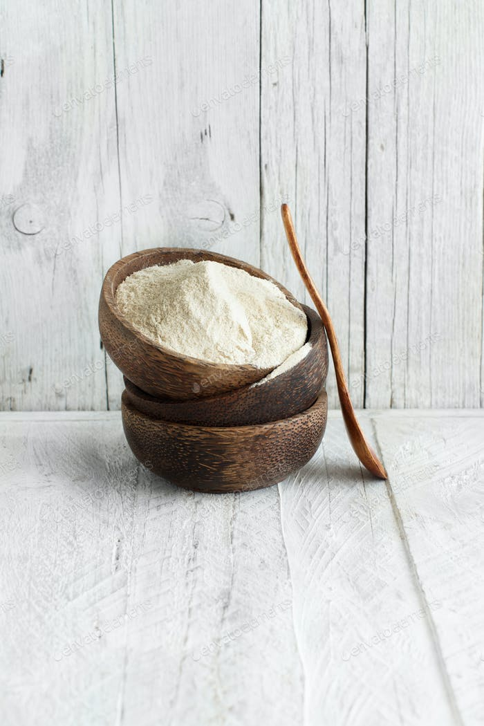 Teff flour in a bowl with a spoon