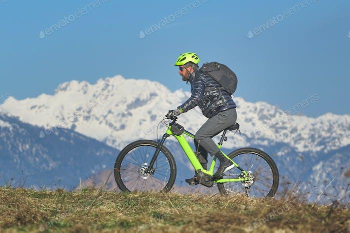 Young man during mountain bike excursion