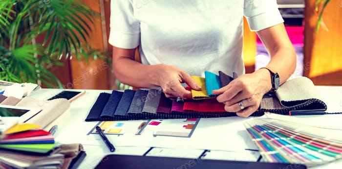 Architect choosing fabric samples