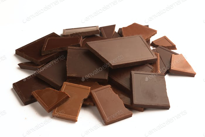 Pile of broken chocolate bars in many colors and flavors