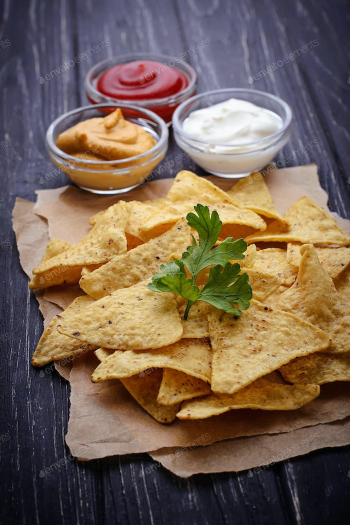 Mexican corn chips nachos with sauce