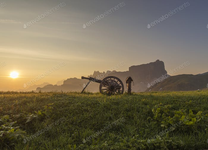 Wooden cannon at passo di Giau at Sunrise. Mountains are behind.