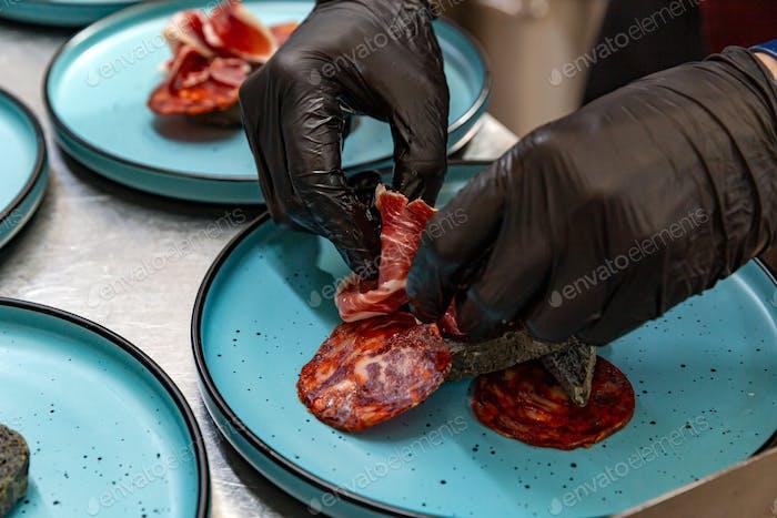 Chef arranging jamon