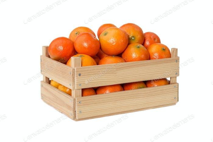 Fresh mandarins in wooden box