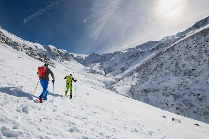 Couple of friends uphill with skis and seal skins