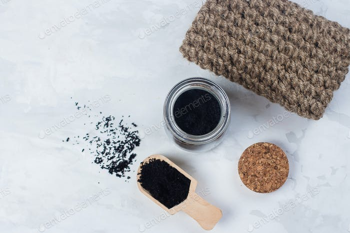 Homemade scrub made of sugar and ground coffee. Spa, beauty skincare body concept.