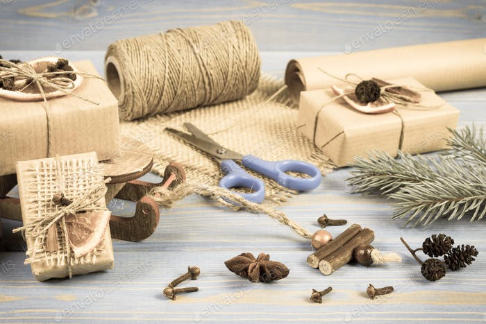 Aged photo, Accessories, decoration and wrapped gifts for Christmas with wooden sled