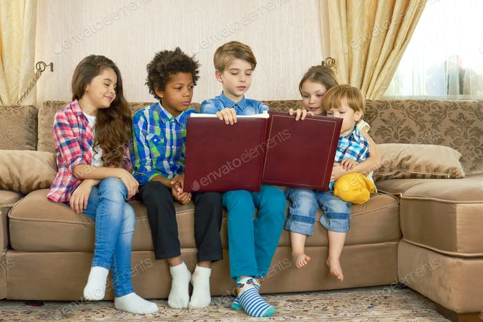 Children with a big book