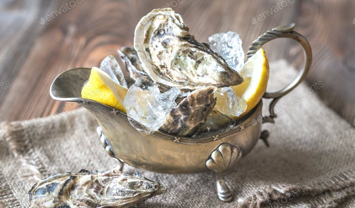 Raw oysters in the gravy boat