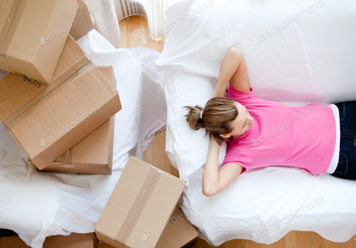 Caucasian woman relaxing between boxes